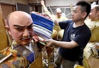 Dolls for a Hakata Gion Yamakasa festival float are seen getting carefully crafted by an artist at a studio in Fukuoka's Hakata Ward on June 14, 2021. (Mainichi/Yoshiyuki Hirakawa)