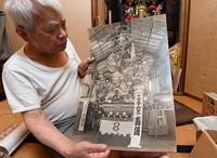 90-year-old doll artist Masahiro Okiayu shows a photo of a Yamakasa float, which craftspeople including his father and himself created more than half a century ago, in Fukuoka's Hakata Ward on June 14, 2021. (Mainichi/Yoshiyuki Hirakawa)