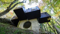 The exterior of Capsule House-K is seen in this photo taken by Shinjiro Yamada and provided by the Capsule Architecture Project.=Click/tap photo for more images.