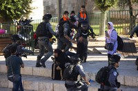 """Israeli police arrest a Palestinian man at a protest at the Damascus Gate to the Old City of Jerusalem on June 17, 2021, against incendiary chants used by ultranationalist Israelis at their """"Flags March"""" on the same site. (AP Photo/Maya Alleruzzo)"""