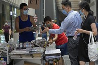 People queue up to buy Apple Daily at a downtown street in Hong Kong on June 18, 2021. (AP Photo/Vincent Yu)