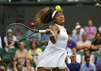 Japan's Naomi Osaka returns to Kazakhstan's Yulia Putintseva in a women's singles match during day one of the Wimbledon Tennis Championships in London, in this July 1, 2019, file photo. (AP Photo/Kirsty Wigglesworth)