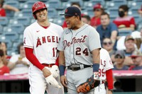 Los Angeles Angels' Shohei Ohtani, left, laughs with Detroit Tigers first baseman Miguel Cabrera at first during the first inning of a baseball game in Anaheim, California, on June 17, 2021. (AP Photo/Alex Gallardo)