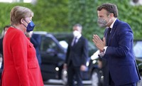 German Chancellor Angela Merkel, left, welcomes the President of France, Emmanuel Macron, right, for a meeting at the chancellery in Berlin, Germany, on June 18, 2021. (AP Photo/Michael Sohn)