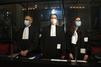 In this May 26, 2021, file photo, lawyers for AstraZeneca Clemence Van Muylder, right, and Hakim Boularbah, left, wait for the start of a hearing, European Commission vs AstraZeneca, at the main courthouse in Brussels. (AP Photo/Virginia Mayo)