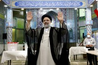 Ebrahim Raisi, a candidate in Iran's presidential elections waves to the media after casting his vote at a polling station in Tehran, Iran on June 18, 2021. (AP Photo/Ebrahim Noroozi)