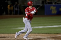 Los Angeles Angels' Shohei Ohtani watches his solo home run against the Oakland Athletics during the eighth inning of a baseball game in Oakland, Calif., on June 15, 2021. (AP Photo/Jed Jacobsohn)