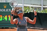 In this May 12, 2021, file photo, Naomi Osaka of Japan reacts after losing a point against Jessica Pegula of the United States during their match at the Italian Open tennis tournament, in Rome. (AP Photo/Alessandra Tarantino)