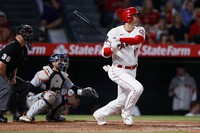 Los Angeles Angels' Shohei Ohtani watches his two-run home run next to Detroit Tigers catcher Eric Haase, center, and umpire Ryan Blakney during the fifth inning of a baseball game in Anaheim, Calif., on June 18, 2021. (AP Photo/Alex Gallardo)