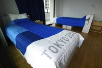 Recyclable cardboard beds and mattresses for athletes are seen during a media tour at the Olympic and Paralympic Village for the Tokyo 2020 Games, constructed in the Harumi waterfront district of Tokyo, Sunday, June 20, 2021. (Akio Kon/Pool Photo via AP)