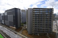 Residential buildings for athletes stand during a media tour at the Olympic and Paralympic Village for the Tokyo 2020 Games, constructed in the Harumi waterfront district of Tokyo, on Sunday, June 20, 2021. (Akio Kon/Pool Photo via AP)