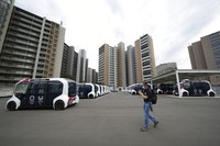 Autonomous electric vehicles which will be used around the main facilities, are seen during a press tour of the Tokyo 2020 Olympic and Paralympic Village on Sunday, June 20, 2021, in Tokyo. (AP Photo/Eugene Hoshiko)
