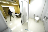 A journalist films a processing room of the Doping Control Station at the Tokyo 2020 Olympic and Paralympic Village during a press tour on Sunday, June 20, 2021, in Tokyo. (AP Photo/Eugene Hoshiko)