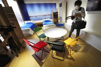 Replica sets of bedroom furniture, including cardboard beds, for the Tokyo 2020 Olympic and Paralympic Villages are shown in a display room at the Village Plaza on Sunday, June 20, 2021, in Tokyo. (AP Photo/Eugene Hoshiko)