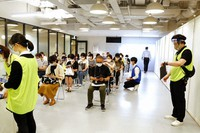 Medical workers wait to get Moderna's COVID-19 vaccine at an inoculation site set up by Japanese technology company SoftBank Group Corp. at a WeWork office Tuesday, June 15, 2021, in Tokyo. (AP Photo/Yuri Kageyama)