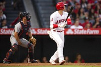 Los Angeles Angels' Shohei Ohtani watches his two-run home run during the third inning of the team's baseball game against the Detroit Tigers in Anaheim, Calif., Saturday, June 19, 2021. (AP Photo/Kyusung Gong)