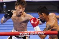Naoya Inoue, of Japan, hits Michael Dasmarinas, of the Philippines, in a bantamweight title fight Saturday, June 19, 2021, in Las Vegas. (AP Photo/John Locher)