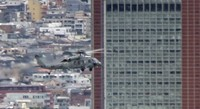 A U.S. Navy Seahawk helicopter passes near the 124-meter Carrot Tower in Tokyo's Setagaya Ward in this frame grab from a Dec. 14, 2020 video shot. (Mainichi/Hiroyuki Oba)