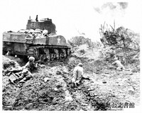 The 713rd Flame-Throwing Tank Battalion destroys Japanese escarpments on coral ridge, during the Okinawa campaign, on May 11, 1945. (Photo Courtesy of the Okinawa Prefectural Archives)