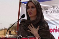 In this image taken from video, Special Envoy to the United Nations High Commissioner for Refugees Angelie Jolie speaks at the Malian refugee camp in Goudebo, Burkina Faso, on June 20, 2021, to mark World Refugee day. (AP Photo)