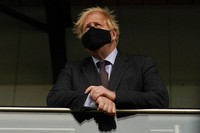 Britain's Prime Minister Boris Johnson visits a vaccination centre at the StoneX Stadium, home of the rugby club Saracens, in North London on June 21, 2021. (AP Photo/Alberto Pezzali, Pool)
