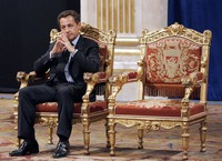 In this May, 24, 2007 file picture, French President Nicolas Sarkozy is seen during an official and traditional ceremony with Paris mayor Bertrand Delanoe, whose empty chair is at right, at the Paris city hall in France. (AP Photo/Christophe Ena)