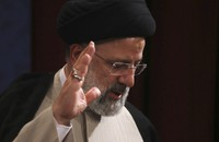 In this June 21, 2021 photo, Iran's new President-elect Ebrahim Raisi waves at the conclusion of his news conference in Tehran, Iran. (AP Photo/Vahid Salemi)