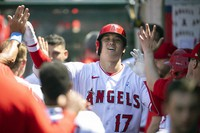 Los Angeles Angels' Shohei Ohtani is greeted in the dugout after hitting a two-run home run during the fifth inning of a baseball game against the Detroit Tigers in Anaheim, Calif., on June 20, 2021. (AP Photo/Kyusung Gong)