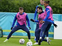 England's Mason Mount, left, and England's Ben Chilwell, second left, during a team training session at Tottenham Hotspur training ground in London, on June 21, 2021 one day ahead of the Euro 2020 soccer championship group D match against Czech Republic. (AP Photo/Frank Augstein)