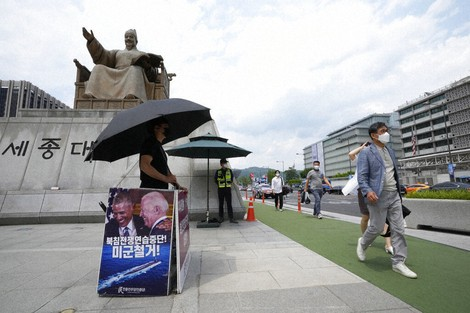 A protester stands to denounce U.S. policies on North Korea near the U.S. Embassy in Seoul, South Korea, on June 22, 2021. (AP Photo/Ahn Young-joon)