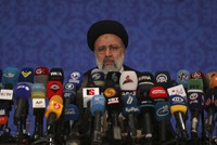 This June 21, 2021 photo shows Iran's new President-elect Ebrahim Raisi during a news conference in Tehran, Iran. (AP Photo/Vahid Salemi)