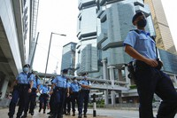 Police officers stand guard as Tong Ying-kit is arriving at a court in Hong Kong on June 23, 2021. (AP Photo/Vincent Yu)