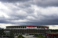 Rain clouds move in over National Stadium on June 23, 2021, in Tokyo, one month before the July 23 opening of Tokyo Olympics. (AP Photo/Kiichiro Sato)