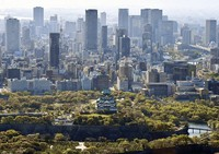 This aerial photo taken from a Mainichi Shimbun helicopter shows Osaka Castle and high-rise buildings in the city of Osaka. (Mainichi/Tadashi Kako)