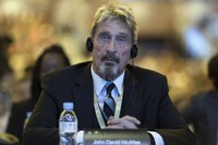 In this Aug. 16, 2016 file photo, software entrepreneur John McAfee listens during the 4th China Internet Security Conference (ISC) in Beijing. (AP Photo/Ng Han Guan)