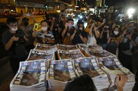 Last issue of Apple Daily arrive at a newspaper booth in Hong Kong, early on June 24, 2021. (AP Photo/Vincent Yu)