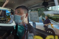 In this July 6, 2020 file photo, Tong Ying-kit arrives at a court in a police van in Hong Kong. (AP Photo/Vincent Yu)