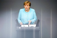 German Chancellor Angela Merkel delivers her specs ahed of a EU summit at the German parliament Bundestag in Berlin, Germany, on June 24, 2021. (AP Photo/Markus Schreiber)