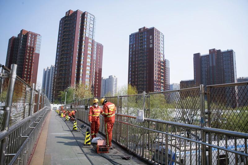 中国では住宅価格の高騰が続く(北京市) (Bloomberg)