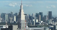 A U.S. Army Black Hawk helicopter is seen flying near Shinjuku Station in Tokyo from the Tokyo Metropolitan Government first main building's south observatory room at around 1:50 p.m. on Oct. 26, 2020. NTT Docomo Yoyogi Building is seen in the background. (Mainichi/Hiroyuki Oba)