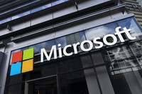 This May 6, 2021 photo shows a sign for Microsoft offices in New York. (AP Photo/Mark Lennihan)
