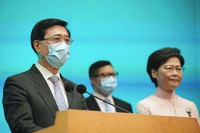 From right, Hong Kong's Chief Executive Carrie Lam, Secretary for Security Chris Tang and Chief Secretary John Lee attend a news conference in Hong Kong, on June 25, 2021. (AP Photo/Kin Cheung)