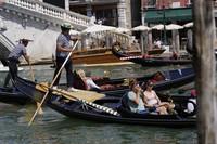 Tourists enjoy a Venetian gondola tour, in Venice, Italy, on June 17, 2021. (AP Photo/Luca Bruno)