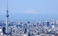 This April 25, 2020 photo taken from a Mainichi Shimbun helicopter shows Tokyo Skytree, left, with Mount Fuji in the background. (Mainichi)