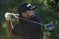 Satoshi Kodaira watches his shot off the seventh tee during the first round of the Travelers Championship golf tournament at TPC River Highlands on June 24, 2021, in Cromwell, Connecticut. (AP Photo/John Minchillo)
