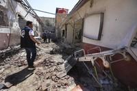 A man walks through a heavily damaged hospital in the city of Afrin, Syria, on June 13, 2021. (AP Photo/Ghaith Alsayed)