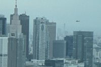 Two U.S. Army Black Hawk helicopters fly at low altitudes over Tokyo's bustling Shinjuku district. The first chopper appears to be flying lower than the top of the 203-meter Mode Gakuen Cocoon Tower, in this still captured from video taken from about 200 meters up in a Tokyo building on July 9, 2020. (Mainichi/Hiroyuki Oba)