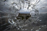 In this May 6, 2021 file photo, the city of Mekele is seen through a bullet hole in a stairway window of the Ayder Referral Hospital, in the Tigray region of northern Ethiopia. (AP Photo/Ben Curtis)