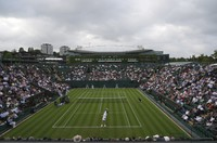 Argentina's Federico Delbonis serves to Russia's Andrey Rublev during the men's singles match on day one of the Wimbledon Tennis Championships in London, on June 28, 2021. (AP Photo/Alberto Pezzali)