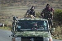 In this May 8, 2021 file photo, Ethiopian government soldiers ride in the back of a truck on a road near Agula, north of Mekele, in the Tigray region of northern Ethiopia. (AP Photo/Ben Curtis)